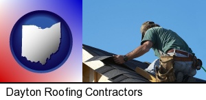a roofing contractor installing asphalt roof shingles in Dayton, OH