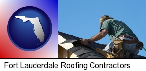 Fort Lauderdale, Florida - a roofing contractor installing asphalt roof shingles