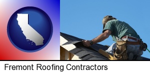 Fremont, California - a roofing contractor installing asphalt roof shingles