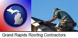 a roofing contractor installing asphalt roof shingles in Grand Rapids, MI