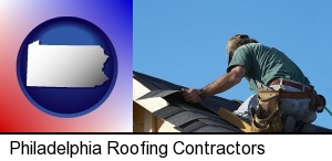 a roofing contractor installing asphalt roof shingles in Philadelphia, PA