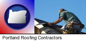 a roofing contractor installing asphalt roof shingles in Portland, OR