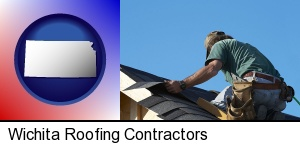 Wichita, Kansas - a roofing contractor installing asphalt roof shingles