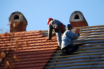 roofers installing a tile roof