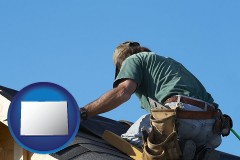 colorado map icon and a roofing contractor installing asphalt roof shingles