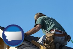 montana map icon and a roofing contractor installing asphalt roof shingles