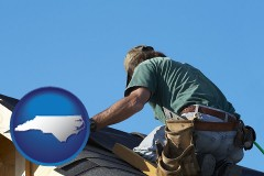 north-carolina map icon and a roofing contractor installing asphalt roof shingles