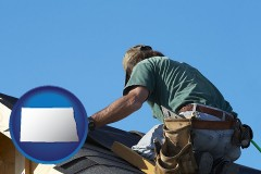 north-dakota map icon and a roofing contractor installing asphalt roof shingles