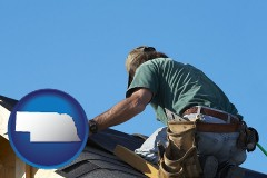 nebraska map icon and a roofing contractor installing asphalt roof shingles
