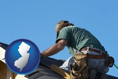 new-jersey map icon and a roofing contractor installing asphalt roof shingles