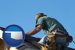 oklahoma map icon and a roofing contractor installing asphalt roof shingles