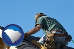 south-carolina map icon and a roofing contractor installing asphalt roof shingles