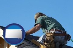 south-dakota map icon and a roofing contractor installing asphalt roof shingles