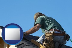 wyoming map icon and a roofing contractor installing asphalt roof shingles