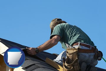 a roofing contractor installing asphalt roof shingles - with Arkansas icon