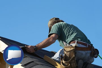 a roofing contractor installing asphalt roof shingles - with Connecticut icon