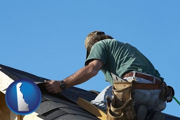 a roofing contractor installing asphalt roof shingles - with Delaware icon