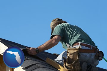 a roofing contractor installing asphalt roof shingles - with Florida icon