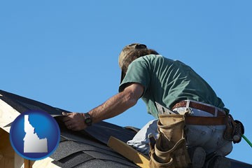 a roofing contractor installing asphalt roof shingles - with Idaho icon