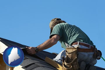 a roofing contractor installing asphalt roof shingles - with Maine icon