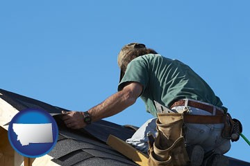 a roofing contractor installing asphalt roof shingles - with Montana icon
