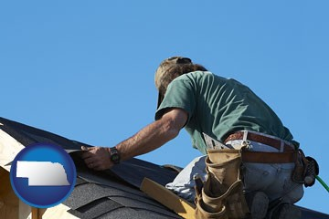 a roofing contractor installing asphalt roof shingles - with Nebraska icon