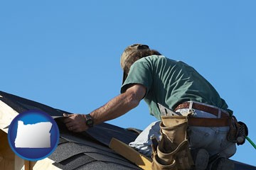 a roofing contractor installing asphalt roof shingles - with Oregon icon